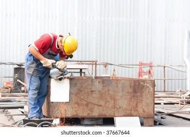 worker grinding metal