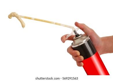 Worker hand holding polyurethane expanding foam glue gun applicator. Balon foam. Isolated on white background