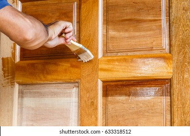 Worker hand painting wooden door with paintbrush linseed oil varnish paint on wood & Varnished Doors Images Stock Photos u0026 Vectors | Shutterstock