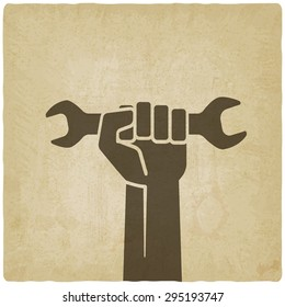 worker hand with wrench symbol old background - illustration