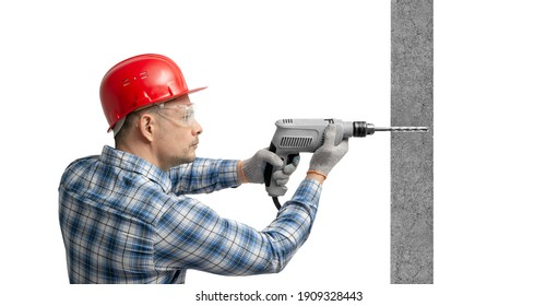 worker handyman or builder worked with construction tools electric drill perforator drilled concrete wall, on white background, isolated. Repair service and construction concept