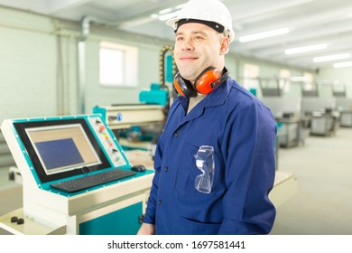 Worker in the Hard Hat Modern Factory CNC machine operator . Successful, Handsome Man in Modern Industrial Environment.Emotions, Copy Space