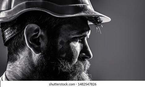 Worker in hardhat. Portrait mechanical worker. Bearded man in suit with construction helmet. Portrait of handsome engineer. Builder in hard hat, foreman or repairman in the helmet. Black and white.