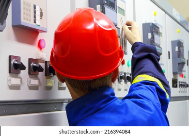 The worker in a helmet, the electrician