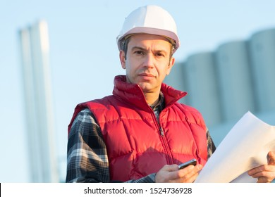 a worker in helmet outdoors