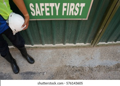 Worker and his safety gear kits on work place with the sign of 'SAFETY FIRST'