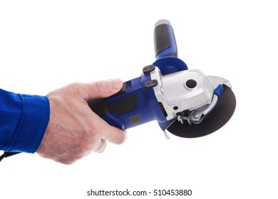 The worker holding angle grinder in his hand isolated on white background.