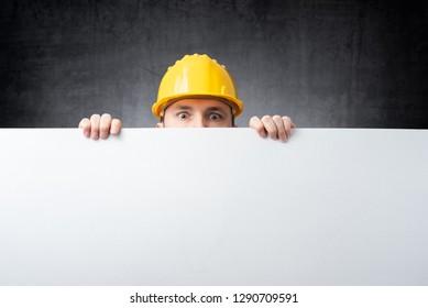 Worker holding blank board