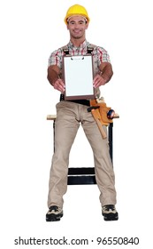 Worker holding clip-board
