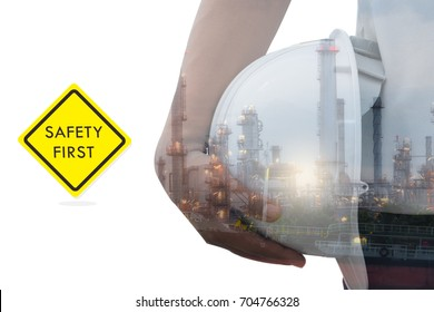 Worker holding an helmet in a Oil refinery industry  , power , fuel ,gas isolated on white background and Warning label Safety. Safety in factory Concept. double exposure picture