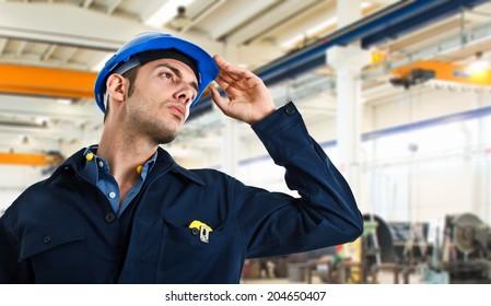 Worker holding his helmet
