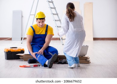 Worker with injured leg and doctor