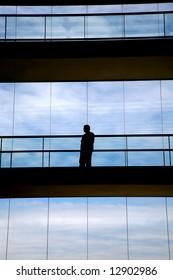 worker inside the modern building in silhouette