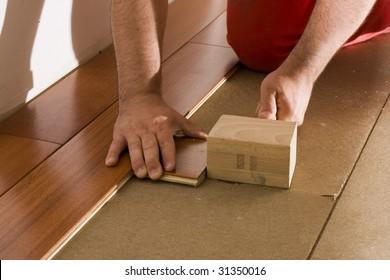 worker install a hardwood floor