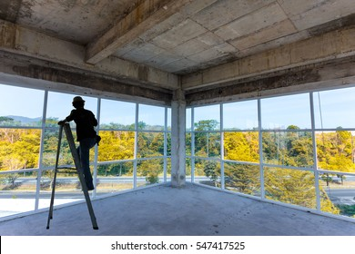 Worker install windows and glass on tall buildings.
