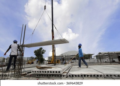 worker installation hollow core slab in construction site