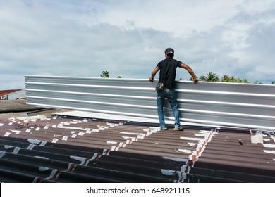 worker installing Metal Sheet roof