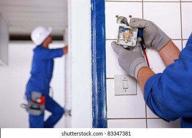Worker installing a plug