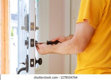 Worker installing or repairing new lock