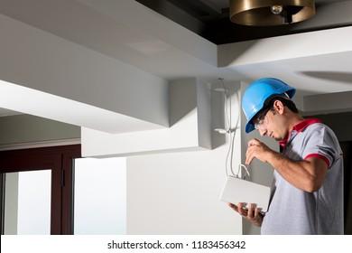 Worker installing speaker