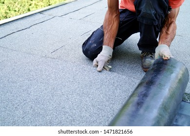 worker installing tar foil on the rooftop of building. Flat roof installation. Waterproof system by gas and fire torching. Roofing felt. Roofer working. Roofer working tool. Waterproofing