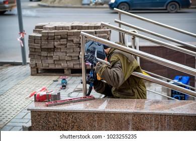 Worker installs rails to underground passage