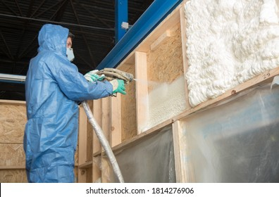 The worker insulates the walls of the house with foam for sound insulation and heat