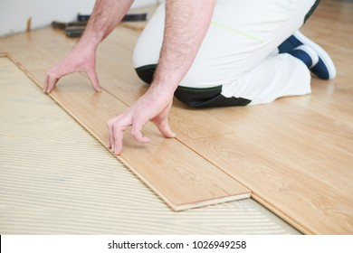 worker joining parquet floor.