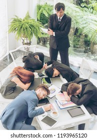 Worker lazy person sleep exhausted with tired meeting. Diversity group of business people sleeping in conference room after meeting. Executive boss and team unhappy depressed in bored conference.