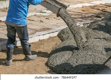 Worker leveling or working with concrete ready mix for build road