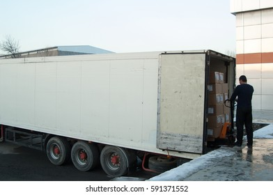 worker loads boxes into a truck