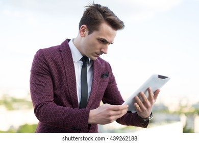 Worker looks at tablet