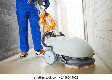 worker with machine cleaning floor in residence hall