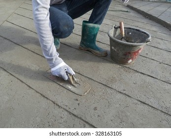 Worker making the level of the concrete slab.Construction work.