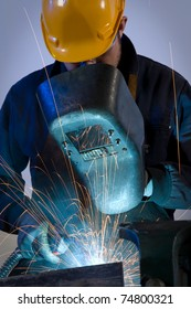 Worker making sparks while welding steel isolated- a series of METAL INDUSTRY images.