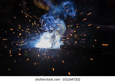 worker making weld