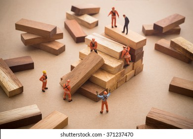 Worker making wood step stair. Success building concept.