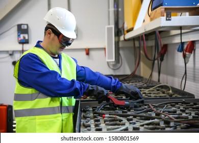 worker man in the battery charging room