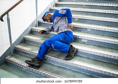 Worker Man Lying On Staircase After Slip And Fall Accident