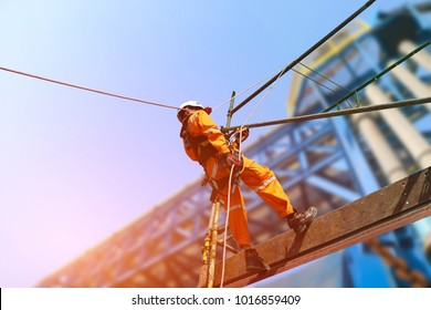 worker man ware safety harness in construction worker on a scaffolding high and safety equipment on building background