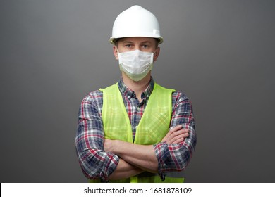 Worker man wearing hygienic mask and protective hard hat. Young engineer worker wear a white helmet and medical face mask. Coronavirus Hygiene, safety concept