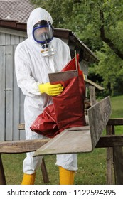 A Worker with mask packing Asbestos Disposal