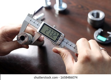 Worker is measuring to the diameter of the small pipe with a digital vernier caliper micrometer. Micrometer, sometimes known as a micrometer screw gauge, is a device incorporating a calibrated screw.