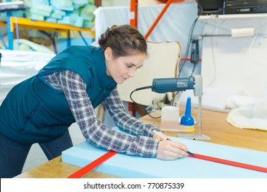 worker measuring a foam