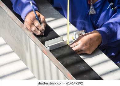 worker with measuring tape and aluminium frame