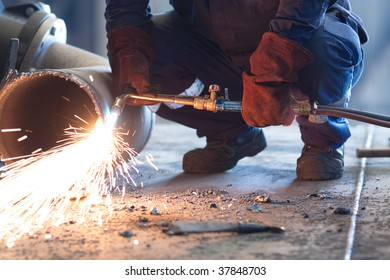 worker melting a pipe and sparks