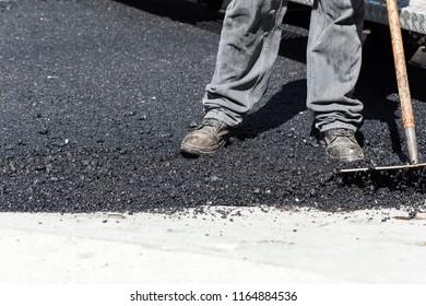 Worker navigating pavement truck, closeup on foot
