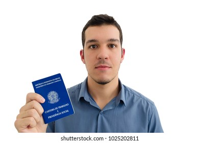 A worker with a new job show his work permit document from Brazil