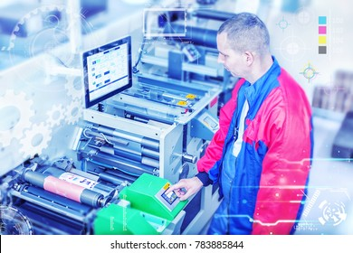 Worker next to the flexographic printing machine inputs the data by pressing the touch screen. Skilled printing operator controls printing machine via the touch screen. Rotary printing press.