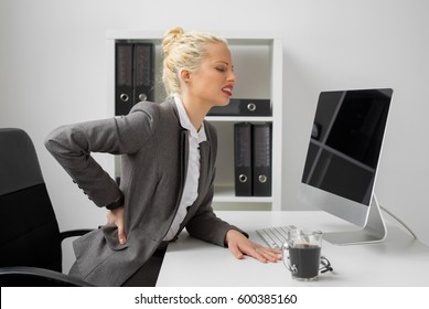 Worker at the office with terrible back pain